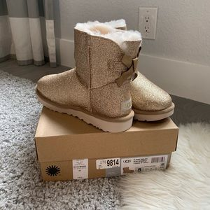 Brand new Ugg Mini Bailey Bow Sparkle Gold Size 8